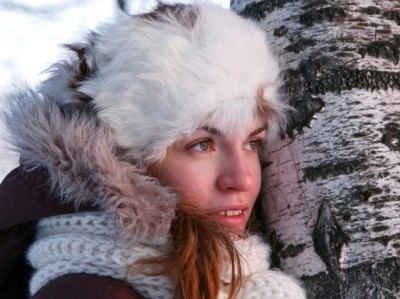 Portrait of young woman in winter outwear